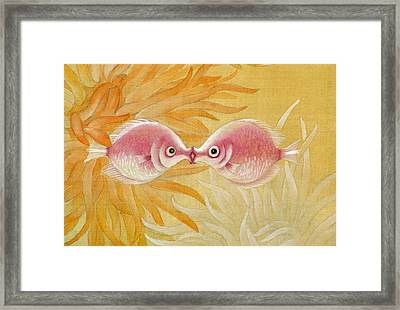 Kissing Fishes Framed Print by Ying Wong