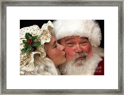 Kissing Santa Claus Framed Print