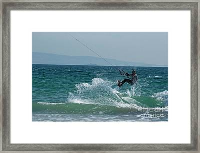 Kite Surfer Jumping Over A Wave Framed Print by Sami Sarkis