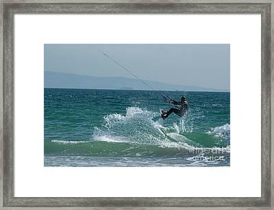 Kite Surfer Jumping Over A Wave Framed Print