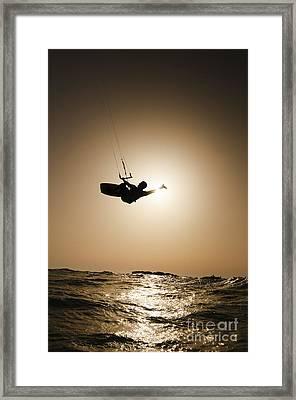 Kitesurfing At Sunset Framed Print by Hagai Nativ