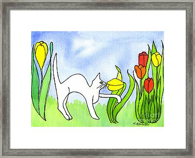 Kitty Sniffing Tulips Framed Print by Norma Appleton