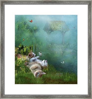 Kitty Wishes Framed Print by Carol Cavalaris