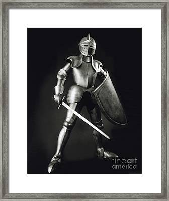 Knight Framed Print by Tony Cordoza