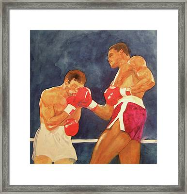 Knockout Punch Framed Print by Nigel Wynter