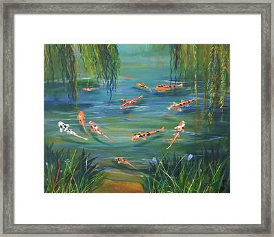 Koi In The  Willows Framed Print