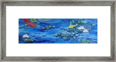 Koi With Water Lilies Framed Print by Annie St Martin