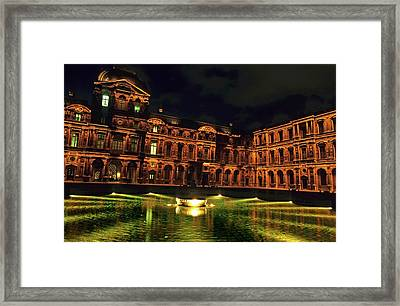 La Cour Carree And The Building Of The Louvre Illuminated At Night Framed Print by Sami Sarkis