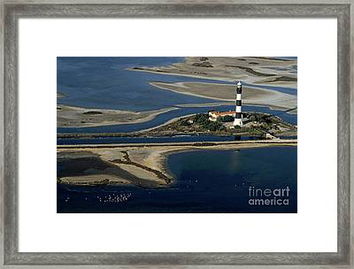La Gacholle Lighthouse Surrounded With Blue Sea In Camargue Framed Print by Sami Sarkis