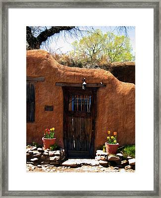 La Puerta Marron Vieja - The Old Brown Door Framed Print by Kurt Van Wagner