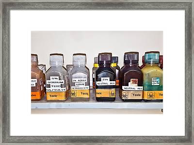 Laboratory Chemicals Framed Print by Tom Gowanlock