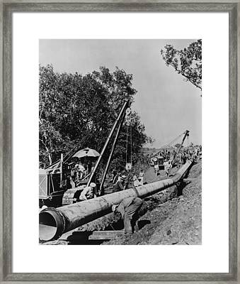 Laborers Laying Pipeline, To Carry Oil Framed Print by Everett