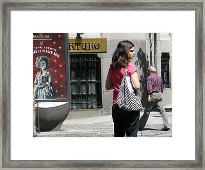 Lady Crossing Sagasta Street - Madrid Framed Print by Thomas Bussmann
