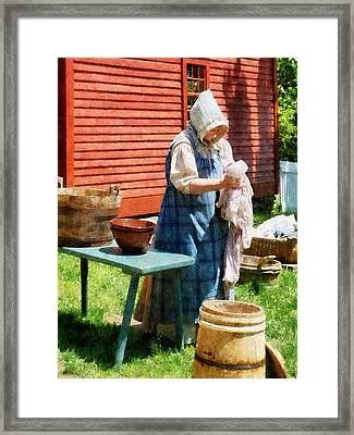 Lady Doing Laundry Framed Print by Susan Savad
