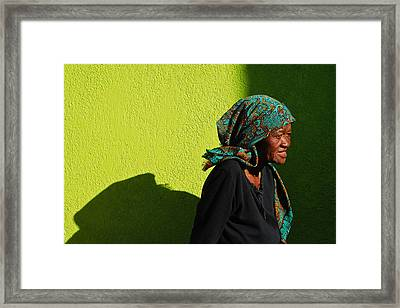 Lady In Green Framed Print