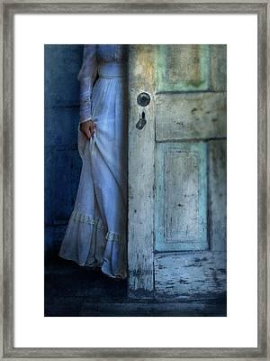 Lady In Vintage Clothing Hiding Behind Old Door Framed Print by Jill Battaglia