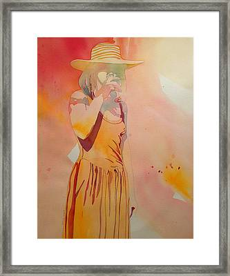 Lady In Yellow Framed Print