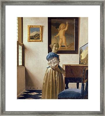 Lady Standing At The Virginal Framed Print by Jan Vermeer