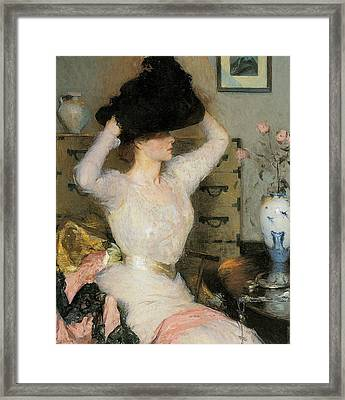 Lady Trying On A Hat Framed Print
