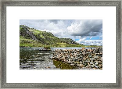 Lake At Idwal Framed Print by Adrian Evans