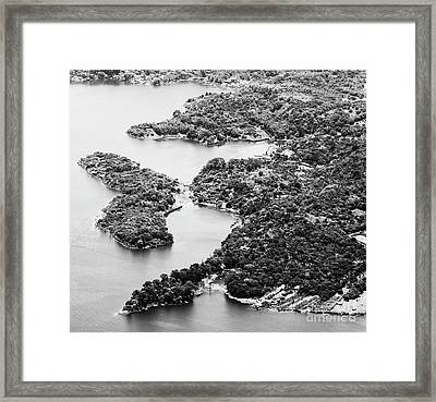 Framed Print featuring the photograph Lake Atitlan Shoreline Town Black And White by Tim Hester