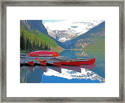 Lake Louise Canoes Framed Print