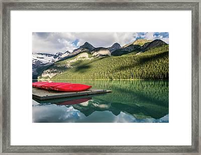 Lake Louise Canoes Framed Print by Joan Carroll