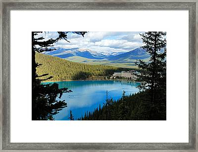 Lake Louise Chalet Framed Print by Larry Ricker