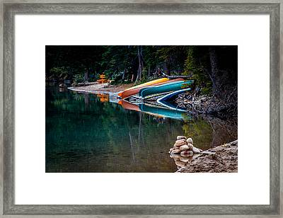 Kayaks At Rest Framed Print