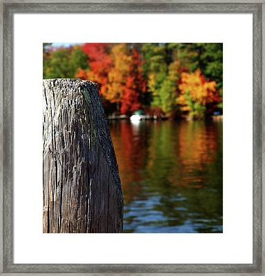 Lake Winnepesaukee Dock With Foliage In The Distance Framed Print