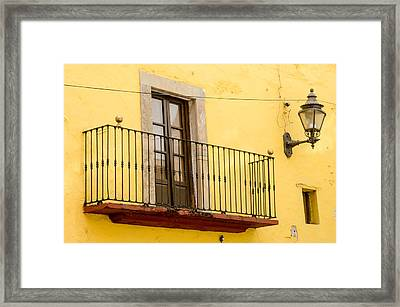 Lamp And Balcony On Yellow Stucco Wall Framed Print