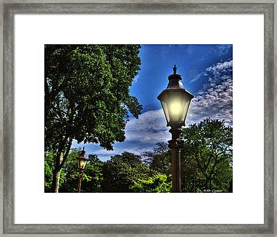 Lamposts Framed Print by Mikki Cucuzzo