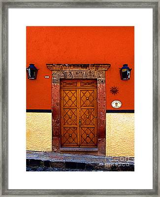 Lamps And Door Framed Print