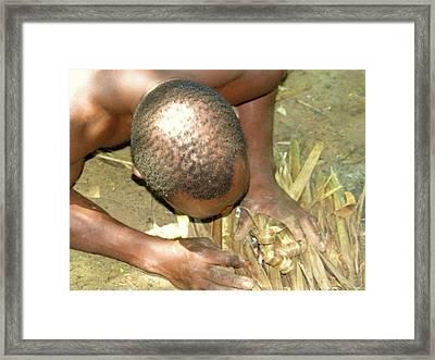 Lamu Island - Man Breathe Life Into A Fire 1 Framed Print