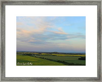 Land Of Living Skies Framed Print by Carrie Gallop
