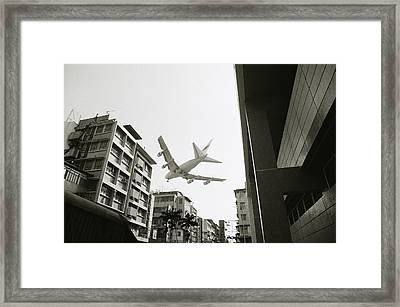 Landing In Hong Kong Framed Print