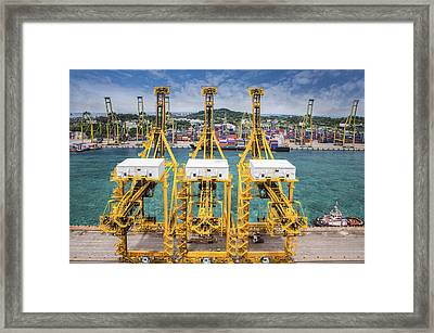 Landscape From Bird View Of Cargo Ships Entering One Of The Busi Framed Print by Anek Suwannaphoom