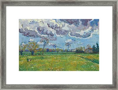 Landscape Under A Turbulent Sky Framed Print by Vincent van Gogh