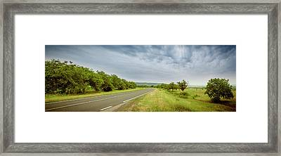 Landscape With Highway And Cloudy Sky Framed Print