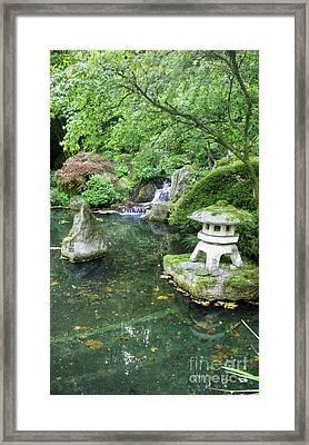 Lantern By The Pond Framed Print by David Bearden
