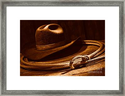 Lariat And Hat - Sepia Framed Print by Olivier Le Queinec