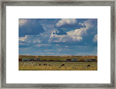 Las Vacas Y El Tren Framed Print by John Vigil
