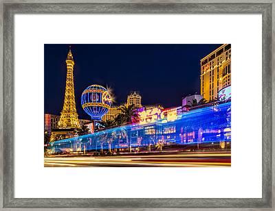 Las Vegas Strip Light Show Framed Print by Susan Candelario