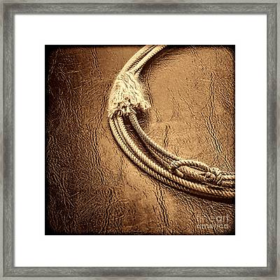 Lasso On Leather Framed Print