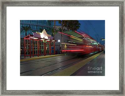 Late For The Trolley Framed Print