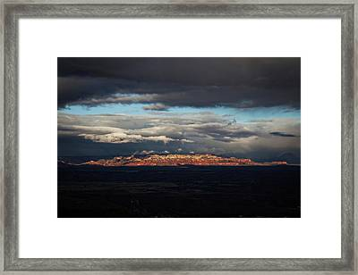 Framed Print featuring the photograph Late Light On Red Rocks With Storm Clouds by Ron Chilston