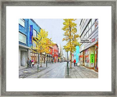 Framed Print featuring the digital art Laugavegur Street In Downtown Reykjavik by Digital Photographic Arts