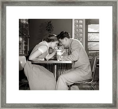 Laughing Couple Sharing A Drink Framed Print