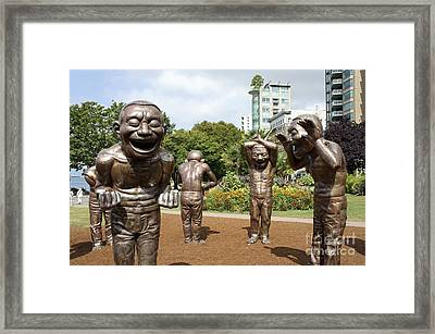 Laughing Men Sculptures Vancouver Canada Framed Print by John  Mitchell