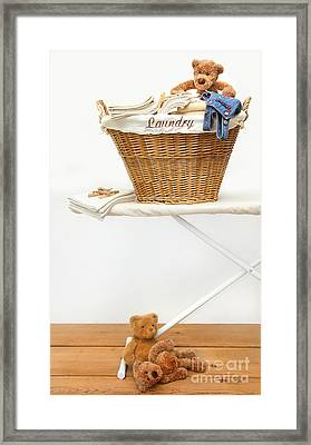 Laundry Basket With Teddy Bears On Floor Framed Print